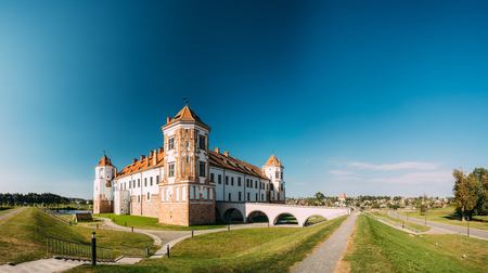 Mir, Belarus. View Of Old Towers Of Mir Castle Complex On Blue Sunny Sky Background. Architectural Ensemble Of Feudalism, Ancient Cultural Monument Stock Photo