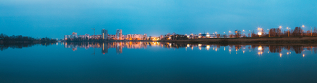 Panoramic View Of Urban Residential Area Overlooks To City Lake Or River And Park In Evening Illumination, Reflecting In Water Surface. Spring In Gomel Belarus. City Residential Architecture