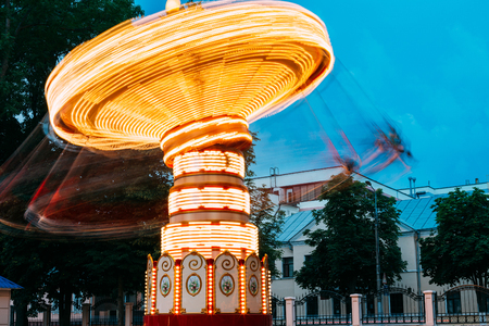 Blurred Motion Effect Of Illuminated Rotating Carousel Merry-Go-Round