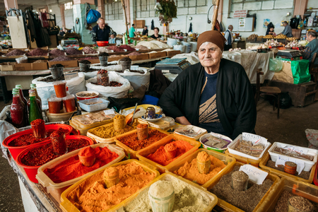 Elderly Georgian Woman, Seller Of Spices Is Waiting For Buyers At The Counter