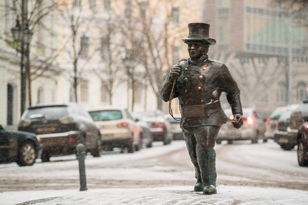Tallinn, Estonia. Bronze Statue Of A Lucky Happy Chimney Sweep With Some Bronze Footsteps
