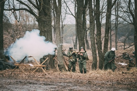 Re-enactors Dressed As German Wehrmacht Infantry Soldier In World War II Open Fire From Panzerschreck