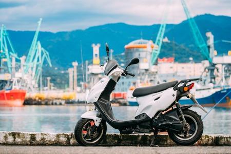 White Sprint Motor Scooter Motorbike Motorcycle Bike Parked Agai