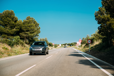 Land Rover Discovery Sport Car Driving In Country Road. Land Rov Redakční