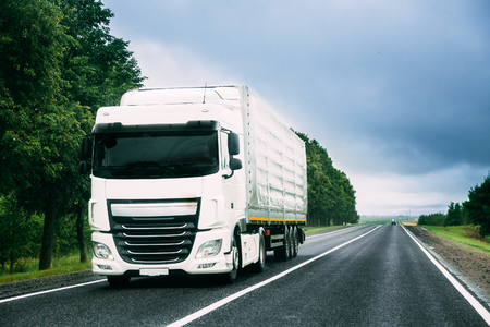 Truck Tractor Unit, Prime Mover, Traction Unit In Motion On Road 스톡 콘텐츠