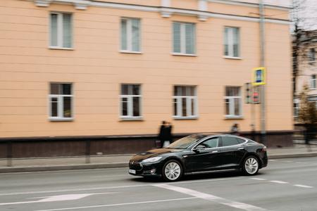Black Color Tesla Model S Car In Motion On Street. The Tesla Mod