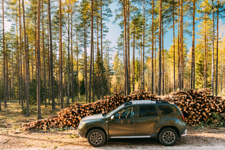 Car Renault Duster SUV in autumn forest landscape. Duster produc