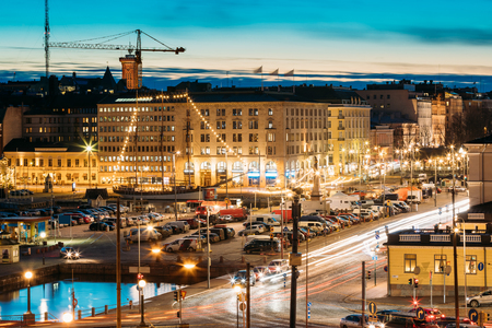 Helsinki, Finland. Evening Night View Of Market Square And Traff