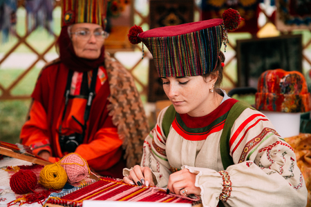 Woman In Ethnic Traditional Folks National Russian Costume Dress Editorial
