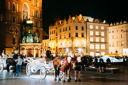 Krakow, Poland. Old-fashioned Coach Carriage At Old Town Square