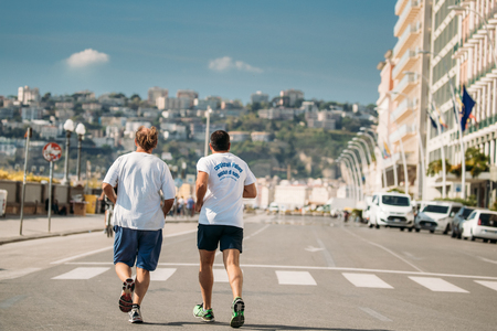 Naples, Italy. Two Adult Caucasian Men Running In Via Partenope Street In Sunny Day.