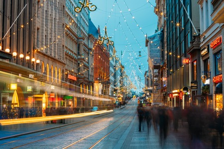 Helsinki, Finland. Tram Departs From Stop On Aleksanterinkatu Street. Night Evening Christmas Xmas New Year Festive Illumination On Street. Beautiful Street Decorations During Winter Holidays Stock Photo - 124126184