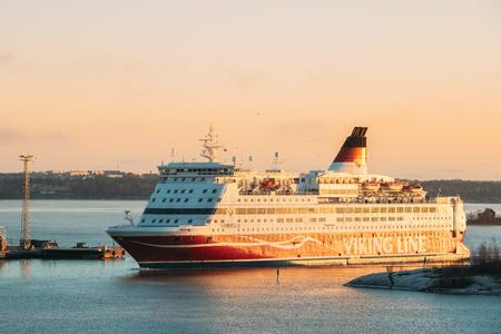 Helsinki, Finland. View Of Modern Ferry Ferryboat Viking Line Floating Near Blekholmen Valkosaari Island At Sunrise Sky.