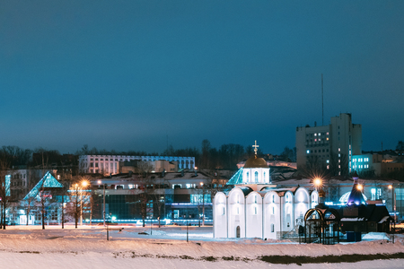 Vitebsk, Belarus. Winter View Of Church Of Annunciation And Wooden Church Of St. Alexander Nevsky In Night Illuminations 版權商用圖片