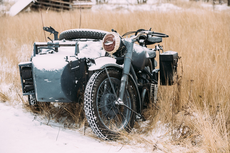 Old Tricar, Three-Wheeled Motorbike Of Wehrmacht, Armed Forces Of Germany Of World War II Time In Winter Forest