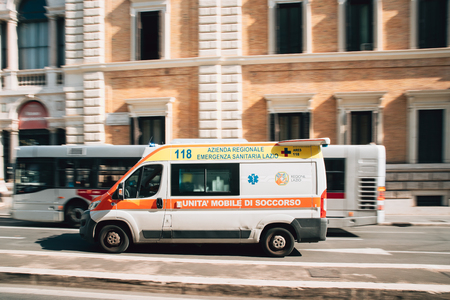 Rome, Italy. Moving With Siren Emergency Ambulance Reanimation Van Car On Street.
