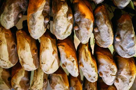 Hanging Italian Dry-cured Ham Prosciutto In Shop. Italian Cuisine Banco de Imagens