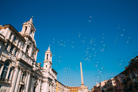 Rome, Italy. Soap Bubbles On Background Of Santagnese In Piazza Navona