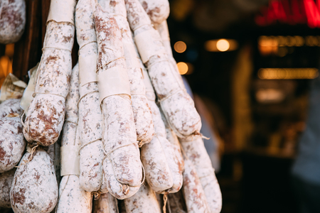 Hanging Cured Sausage Salame Corallina In Local Market. Italian Cuisine