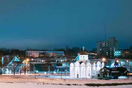 Vitebsk, Belarus. Winter View Of Church Of Annunciation And Wooden Church Of St. Alexander Nevsky In Night Illuminations Banco de Imagens