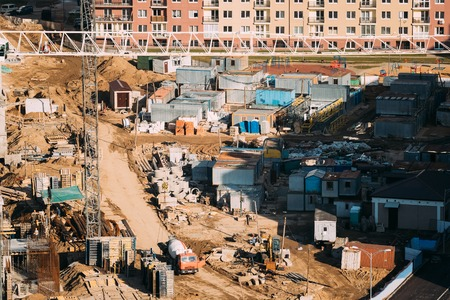 Minsk, Belarus. Special Concrete Transport Truck In-Transit Mixer Unit On City Building Site. Construction Of Houses