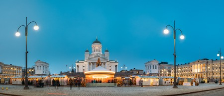Helsinki, Finland. Market On Senate Square With Holiday Carousel And Famous Landmark Is Lutheran Cathedral In Winter Night