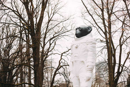 Riga, Latvia. Monkey statue in a spacesuit in Kronvalda park. Statue is dedicated to animals that participated in exploration of outer space. Author is artist Denis Prasolov.