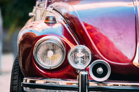 Rome, Italy - October 20, 2018: Close Up Headlight Of Old Retro Vintage Red Color Volkswagen Beetle Car Parked At Street Redakční