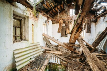 Belarus. Interior Of Ruined Abandoned Private Country House With Caved Roof In Evacuation Zone After Chernobyl Disaster. Terrible Consequences Of Nuclear Contamination