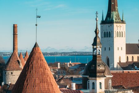 Tallinn, Estonia. Part Of Tallinn City Wall With Towers, At The Top Of Photo There Is Tower Of Church Of St. Olaf Or Olav