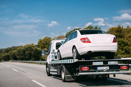 Car Service Transportation Concept. Tow Truck Transporting Car Or Help On Road Transports Wrecker Broken Car. Auto Towing, Tow Truck For Transportation Faults And Emergency Cars . Tow Truck Moving In Motorway Freeway Highway. Zdjęcie Seryjne