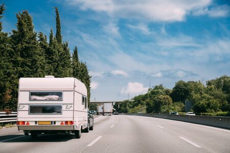 White Caravan Motorhome Car Goes On Highway Road. 스톡 콘텐츠 - 149456779