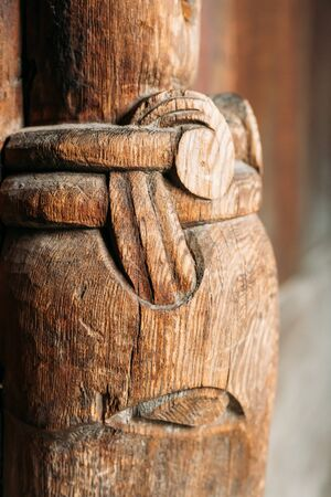 Borgund, Norway. Carved Details Of Famous Wooden Norwegian Landmark Stavkirke. Ancient Old Wooden Triple Nave Stave Church. Close View, Details.