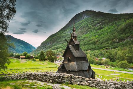 Borgund, Norway. Famous Landmark Stavkirke An Old Wooden Triple Nave Stave Church In Summer Day. Ancient Old Wooden Worship In Norwegian Countryside Landscape. Stock Photo