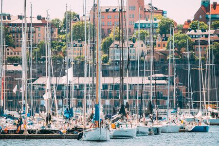 Stockholm, Sweden. Jetty With Many Moored Yachts During Summer Sailing Regatta In Sunny Day.