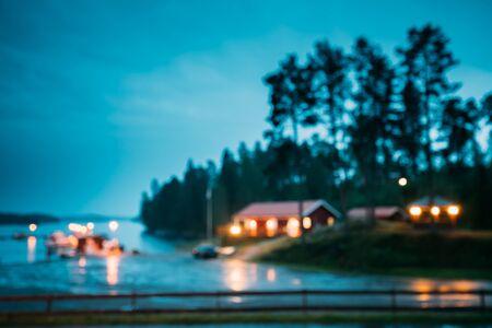 Sweden. Abstract Boke Bokeh Background Effect. Design Backdrop. Beautiful Wooden Pier Near Lake In Summer Evening Night. Lake Or River Landscape. Riverside Archivio Fotografico