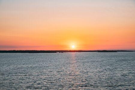 Sweden. Beautiful Seascape In Sunset Sunrise Time. Sun Sunshine Above Rocky Islands Archipelago. Sunny Summer Evening.