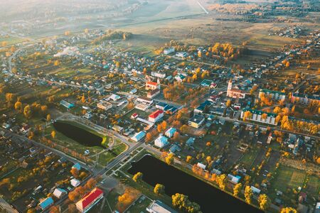 Ruzhany, Brest Region, Belarus. Cityscape Skyline In Autumn Sunny Evening. Birds-eye View Of St Peter and Paul Orthodox Church And Trinity Catholic Church. Famous Historic Landmarks