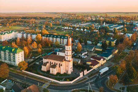 Ruzhany, Brest Region, Belarus. Cityscape Skyline In Autumn Sunny Evening. Birds-eye View Of And Trinity Church. Famous Historic Landmark