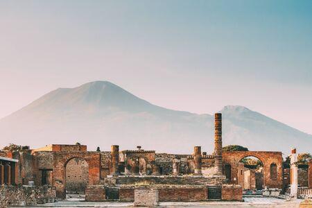 Pompeii, Italy. Temple Of Jupiter Or Capitolium Or Temple Of Capitoline Triad On Background Of Mount Vesuvius