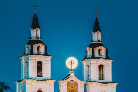 Minsk, Belarus. Moonrise of Full Moon over Cathedral Of Holy Spirit In Minsk. Famous and Main Orthodox Church Of Belarus in Minsk