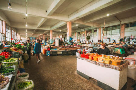 Batumi, Georgia - May 28, 2016: Market Bazar With Sellers And Buyers Among Abundant Counters With Agricultural Output.