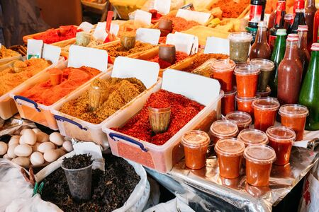 Varicoloured Fragrant Spices In Trays And Abundance Of Traditional Georgian Sauces At Market Counter On Sale.