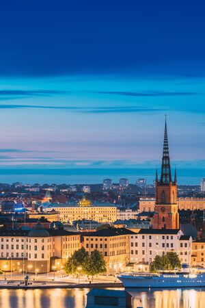 Stockholm, Sweden. Scenic View Of Stockholm Skyline At Summer Evening. Famous Popular Destination Scenic Place In Dusk Lights. Riddarholm Church In Night Lighting