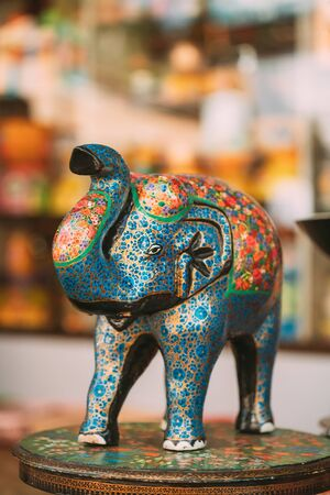 Goa, India. Painted Elephant Souvenir Of Porcelain On Shelf In Store. Goods For Tourists. Imagens