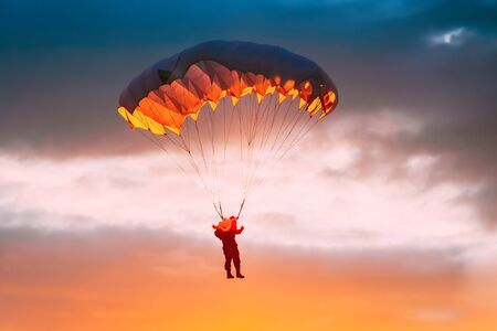Skydiver On Colorful Parachute In Sunny Sky Stok Fotoğraf