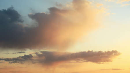 Sunset Sky. Bright Dramatic Sky With Fluffy Clouds. Yellow, Orange Colors. Dawn Sky