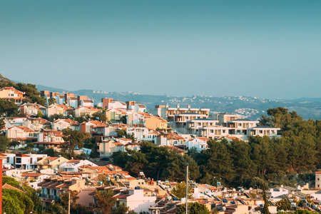 Kusadasi, Turkey. Beautiful Cityscape Of Turkish Town. White Residential Houses On Hillside. Real Estate Suburb In Summer Evening Banque d'images - 150888956