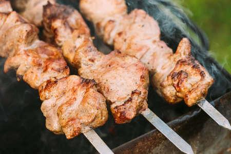 Grilled Barbecue Meat Shashlik Shish Kebab Pork Meat Grilling On Metal Skewer 版權商用圖片