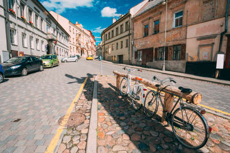 Vilnius, Lithuania. Architecture Of Uzupis Located In Old Town Of Vilnius. District Of Vilniaus Senamiestis. Bicycles Parking In Street